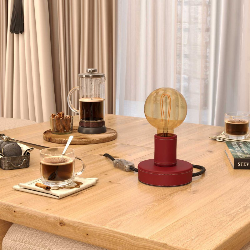 Posaluce Leather, our table lamp in leather complete with fabric cable, switch and 2-pin plug