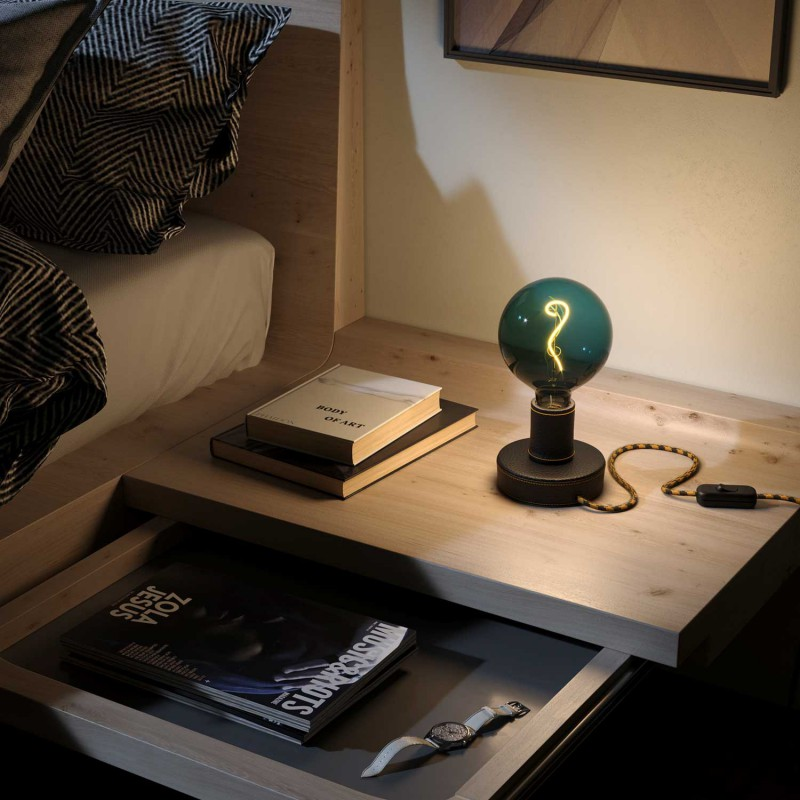 Posaluce Leather, our table lamp in leather complete with fabric cable, switch and UK plug